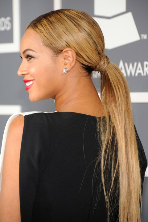 Want to try Beyoncé's perfectly glam pony? Use a boar bristle brush to direct your strands back, then smooth a quarter-size amount of gel from your hairline to the base of your pony to calm any flyways and add shine. Then, put your hair into a low pony and wrap a sliver of hair from under your pony around the elastic band to make it flawless and *~FaNcY~*.