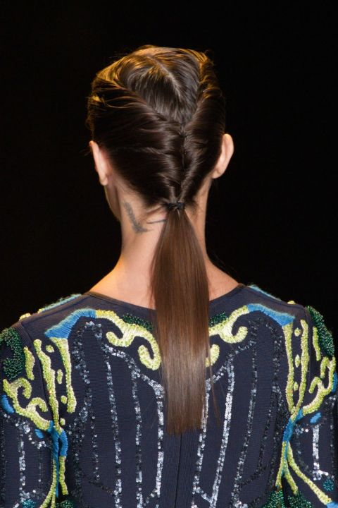 At Herve Leger, the models walked the runway with double-sided French twists that led into a super-low pony and were secured at the nape of their necks with a thin elastic. To get the look, part your hair down the center and work with one side of hair at a time, working it toward the back of your head and then twisting it into itself to create the French twist. Secure with bobby pins and repeat on the opposite side. Lastly, be sure to use a flat iron so the tail lies smoothly from the bottom of the twists down.