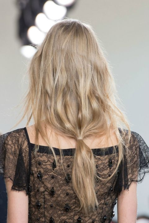 This style is perfect for when you wake up with tons of texture — or if you have naturally wavy hair — and need to run out the door fast. To make your mane look like this model's, tie your hair so the elastic lines up with either the base of your neck or even further down for longer-haired girls. Then, pull out any face-framing pieces to give it an I-woke-up-like-this feel.