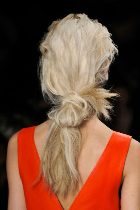 "This has ""brunch hair"" written all over it. To recreate this look, give your hair tons of texture by spraying it with a texturizing spray, such as TRESemmé Perfectly (un)Done Sea Salt Spray. Next, use your fingers to sweep your hair into a low, loose pony at the base of your neck, pulling it through the elastic completely two times but only halfway on the third pull through, so some falls out."
