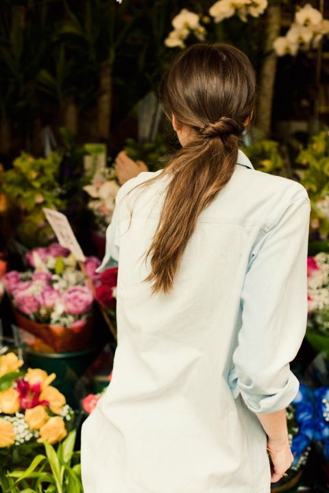 To create this chic low, twisted side pony, separate hair into two sections in the back of your head—leaving most of your hair off to one side, with one much smaller section near your right ear. Secure the larger section into a low pony at the nape of your neck, then take the smaller section and twist the length of it before wrapping it under and around the base of the pony. Once you have only a small amount of hair left, pin it underneath the pony.