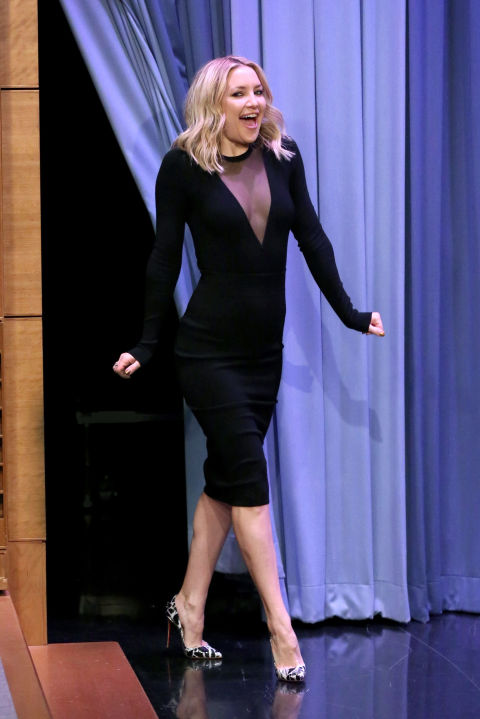 Kate Hudson arrives at The Tonight Show on Monday wearing a black bodysuit with a plunging panel and a pencil skirt, both by Michael Kors.