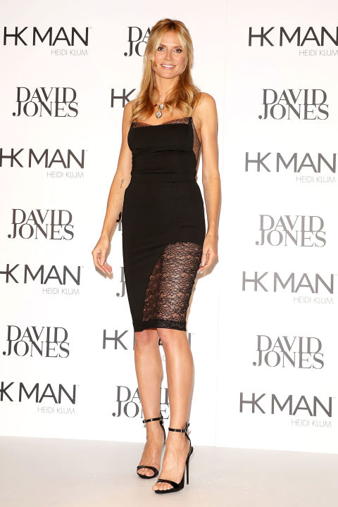 Heidi Klum attends the launch of Heidi Klum Man in Australia on Thursday wearing a black dress with lace paneled details and black strappy sandals.