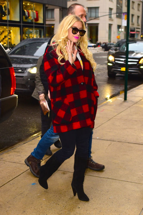 Kesha braves the New York City chill in a plaid coat and boots Tuesday.