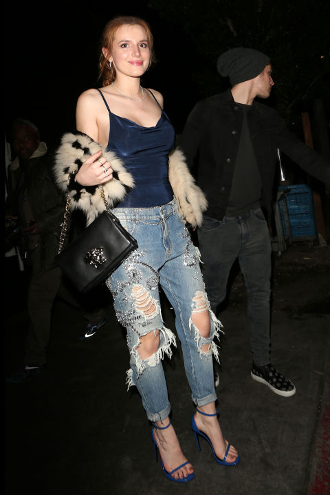 Bella Thorne steps out of The Nice Guy nightclub in West Hollywood with Greg Sulkin, wearing majorly distressed denim, a furry wrap,and a sweet smile.