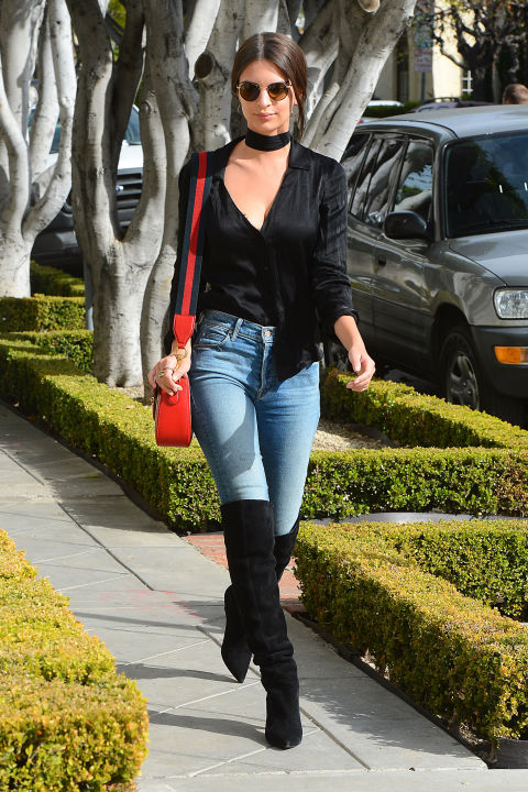 Emily Ratajkowski looks cool and casual on Wednesday in West Hollywood in jeans and an otherwise all-black ensemble and carrying a red Gucci bag.