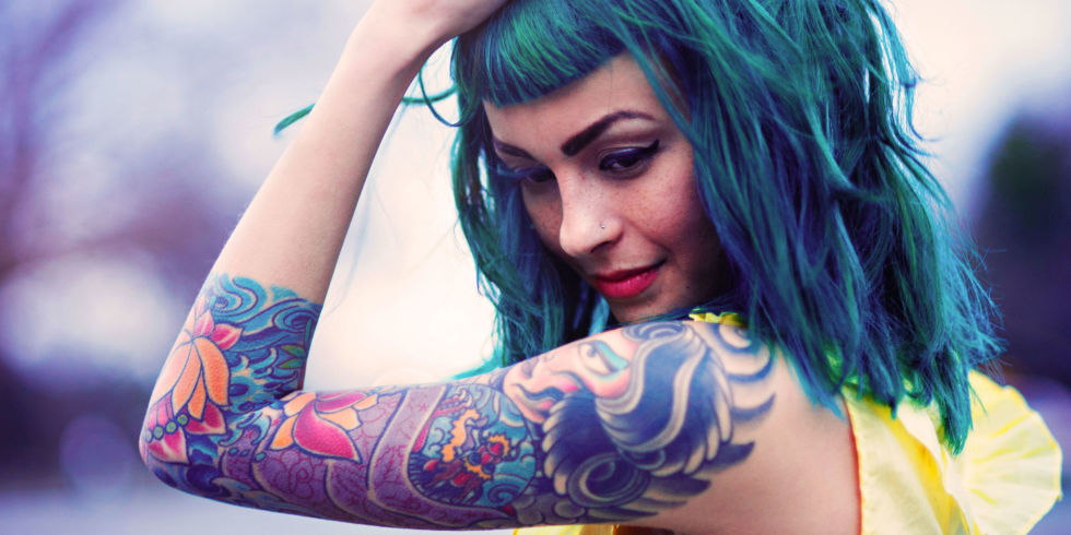 Woman with blue hair and tattoos