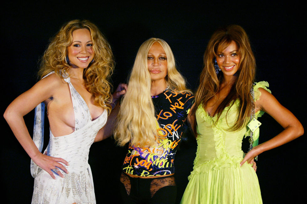 "Mariah smiles confidently with Beyoncé and designer Donatella Versace before Versace's 2004 spring show. ""Your talent is massive as the beauty of your heart,"" Mariah would write of the singer in 2014, to thank her for her birthday greeting."