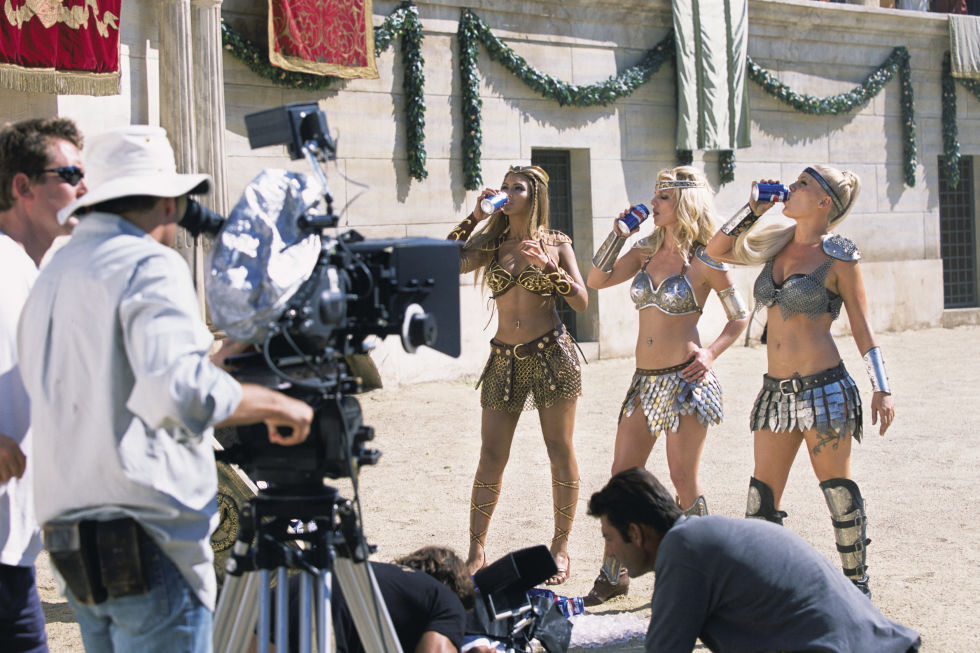 Britney Spears and Pink bond with Queen Bey in Rome, decked out in metallic gladiator gear while filming a Pepsi Super Bowl commercial.
