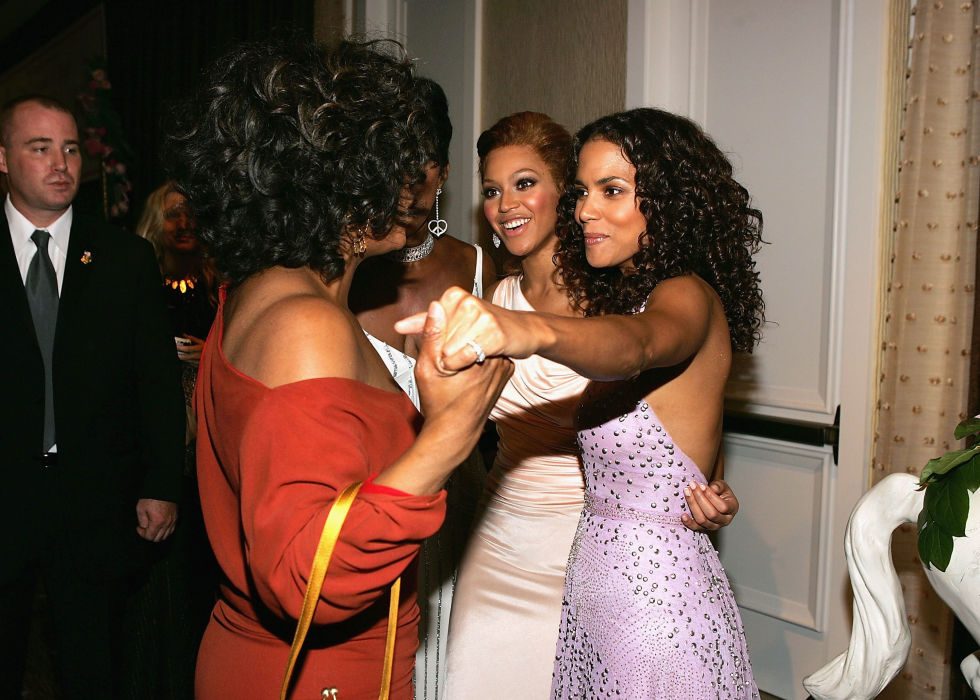 "Oprah and Halle Berry exchange ""can you believe this is happening?!"" looks, hanging with Beyoncé at the 16th Carousel of Hope reception."