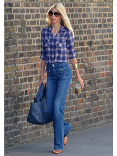Tip: Wide-leg jeans have been huge all summer—fortunately, they transition easily into fall. Pair them with a plaid top for even more '70s flair.  Supermodel Claudia Schiffer got it right in these high-waisted blues.