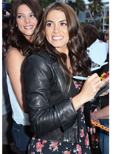 Tip: Feminine floral dresses look great with edgy, rockerish leather jackets—it creates the perfect soft-hard balance.  Twilight star Nikki Reed signed autographs at Comic-Con in a cool, collar-less version.