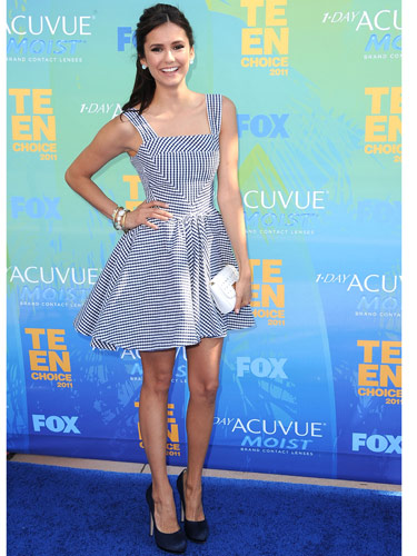 Tip: Switch to pumps. When you swap out strappy sandals for closed-toe heels, your sundress instantly becomes less summery. Vampire Diaries star Nina Dobrev's dress screamed summer, but her blue satin shoes danced her right into fall.