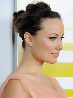 This look isn't just for the gym anymore. Add extra volume like Olivia Wilde, and it's perfect for a holiday party. (You get bonus points if you use a jeweled band.)