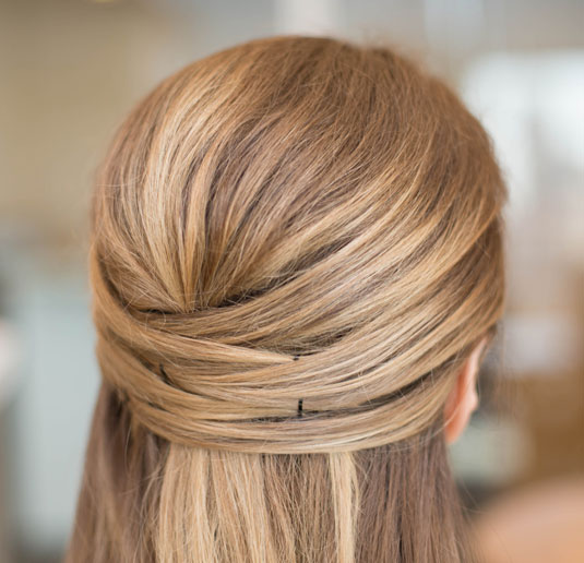 Take sections of hair from the front of your hair bit by bit and grip ...